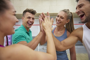 coworkers happy after doing collaboration based team building activities