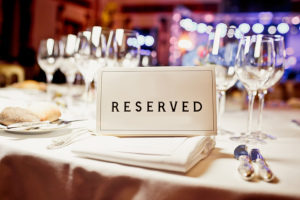 a reserved sign on a table for a private party in a northern virginia restaurant