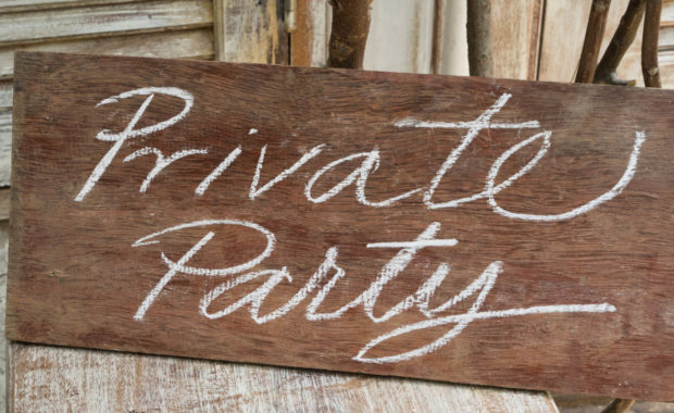 a wooden sign board that says private party on it