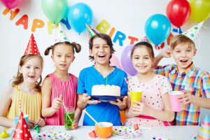 children celebrating a birthday with cake at an escape room