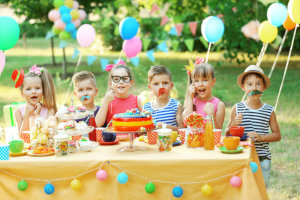 happy kids having a birthday party outside